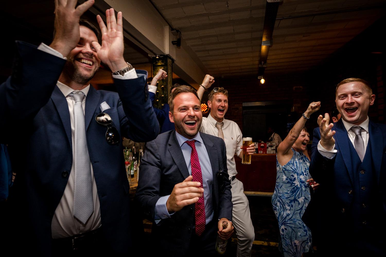 Happy wedding guests at a Victoria Warehouse Wedding