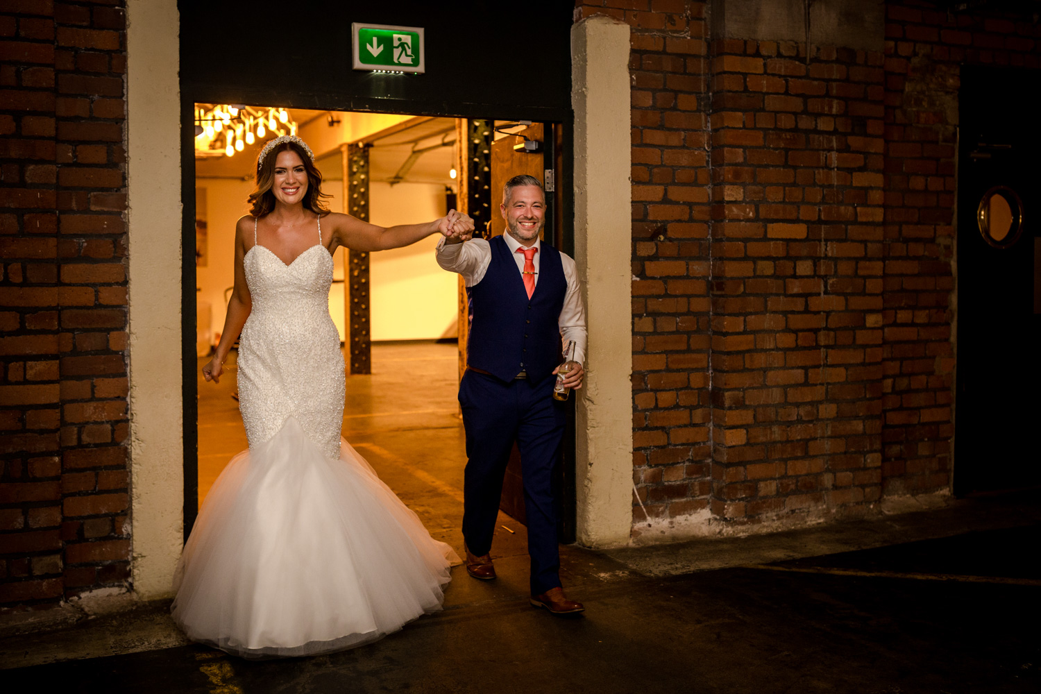 the bride and groom make their entrance at Victoria Warehouse