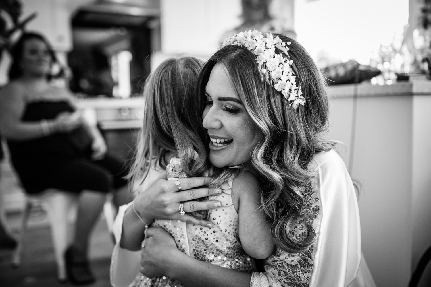 Big cuddles for the flower girl