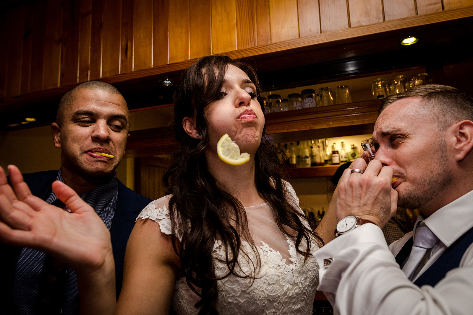 Bride doing tequila shots at Beeston Manor in Lancashire