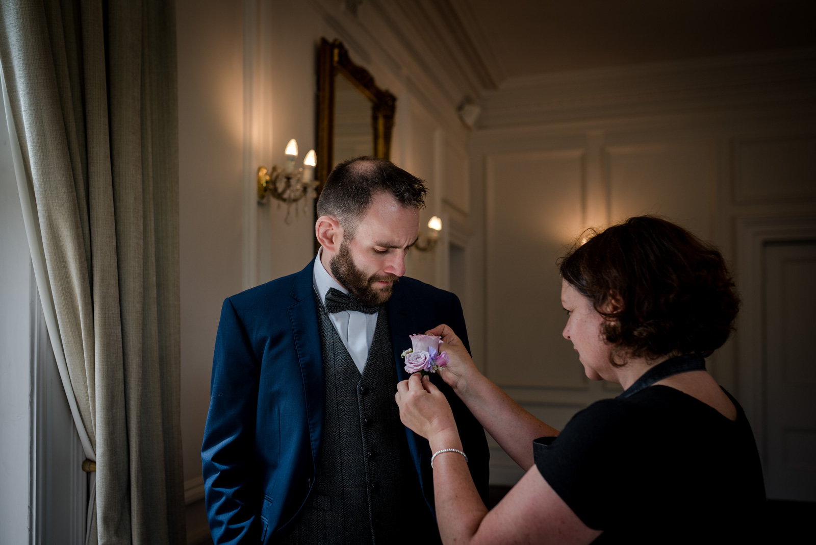The groom getting ready during his Ashfield House Wedding
