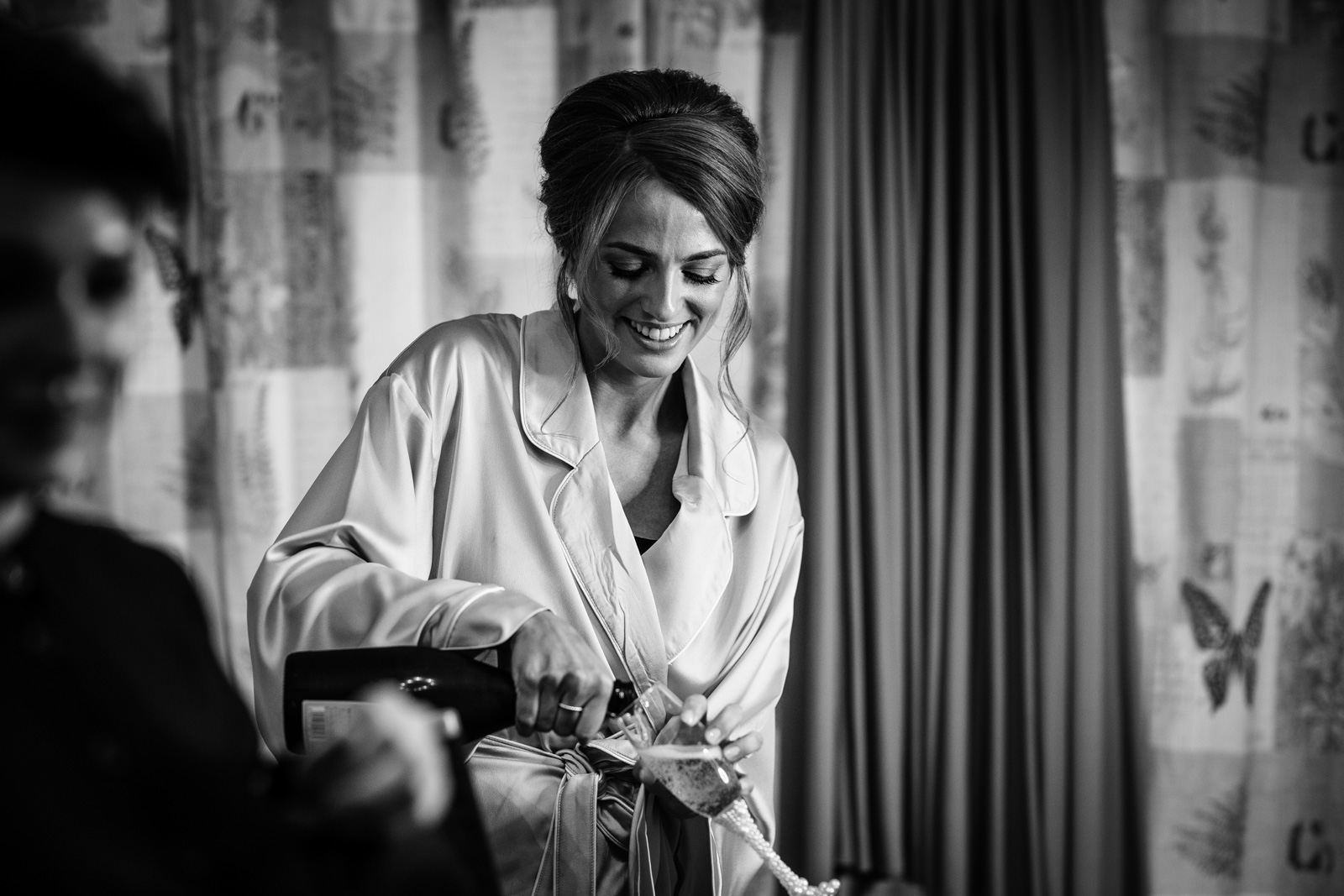 Bridesmaid pouring Champagne