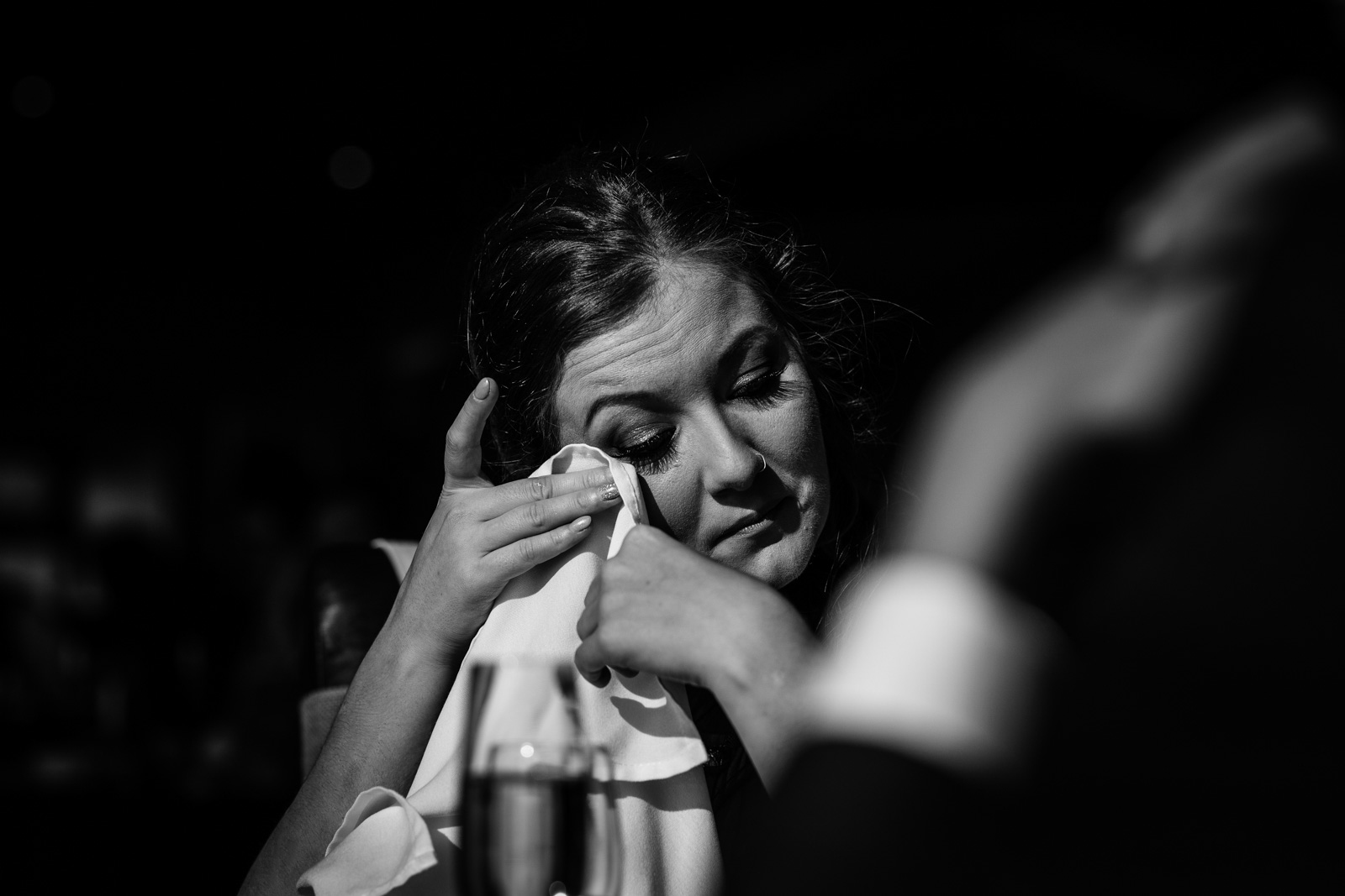 Bridesmaid crying during a Fisherman's Retreat wedding