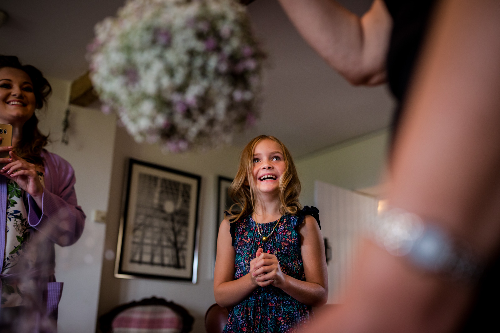 Happy flower girl before a Fisherman's Retreat wedding