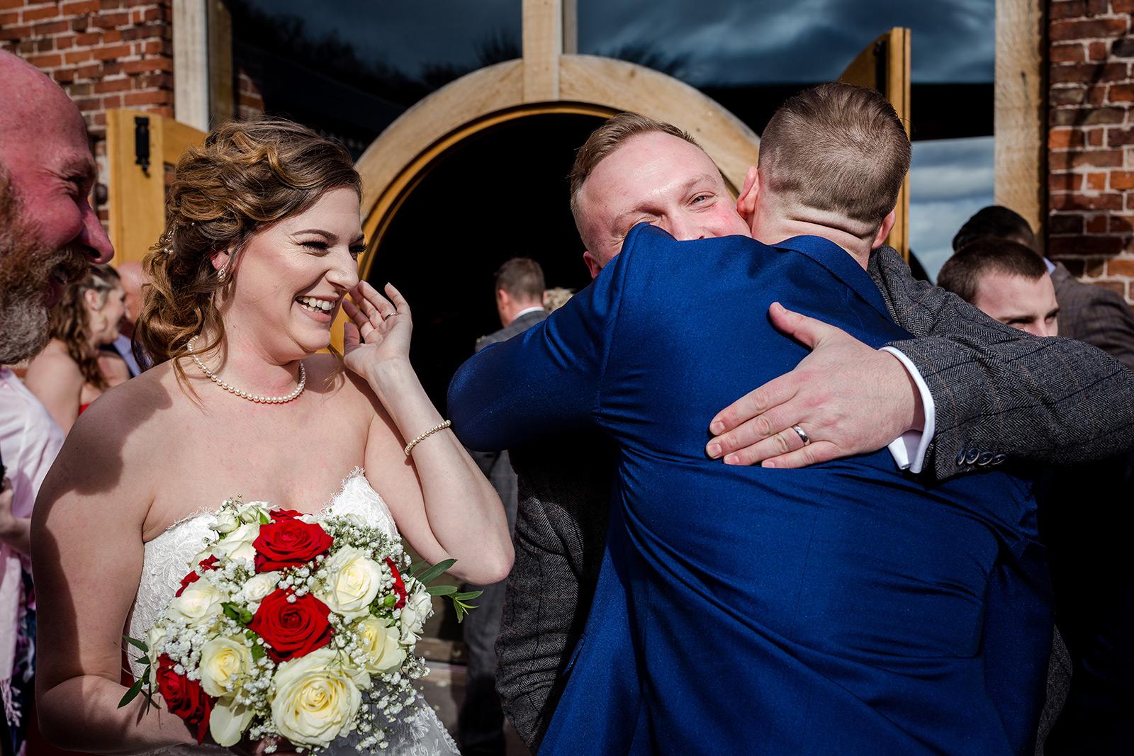 Post ceremony hugs at a Hazel Gap Barn wedding