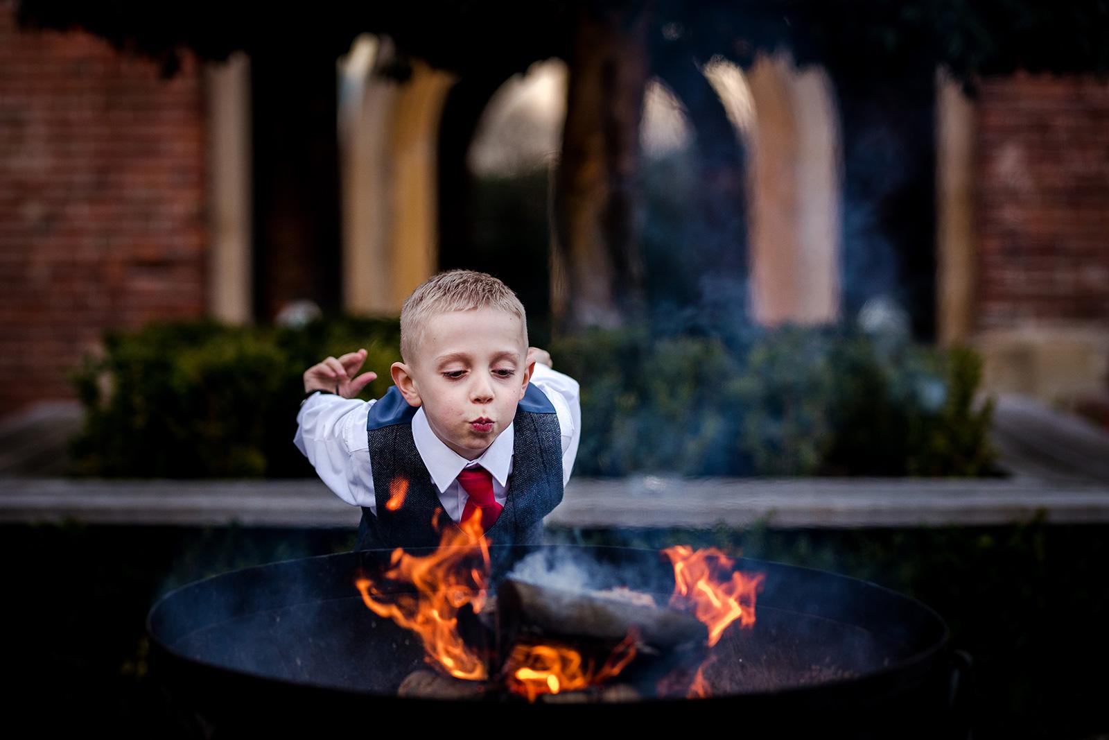 Child playing near fire pit at Hazel Gap Barn