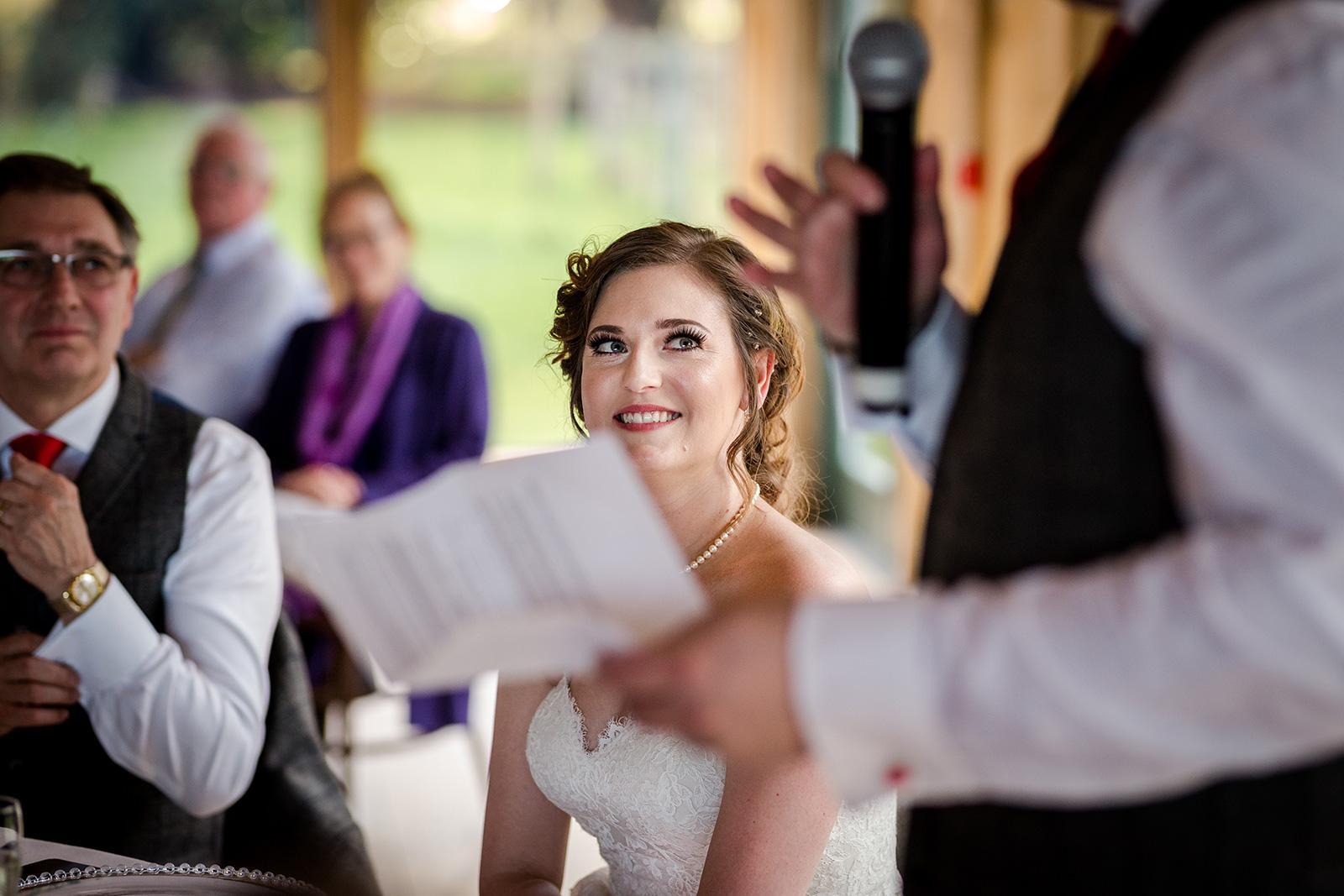 Bride during the grooms speech at Hazel Gap Barn