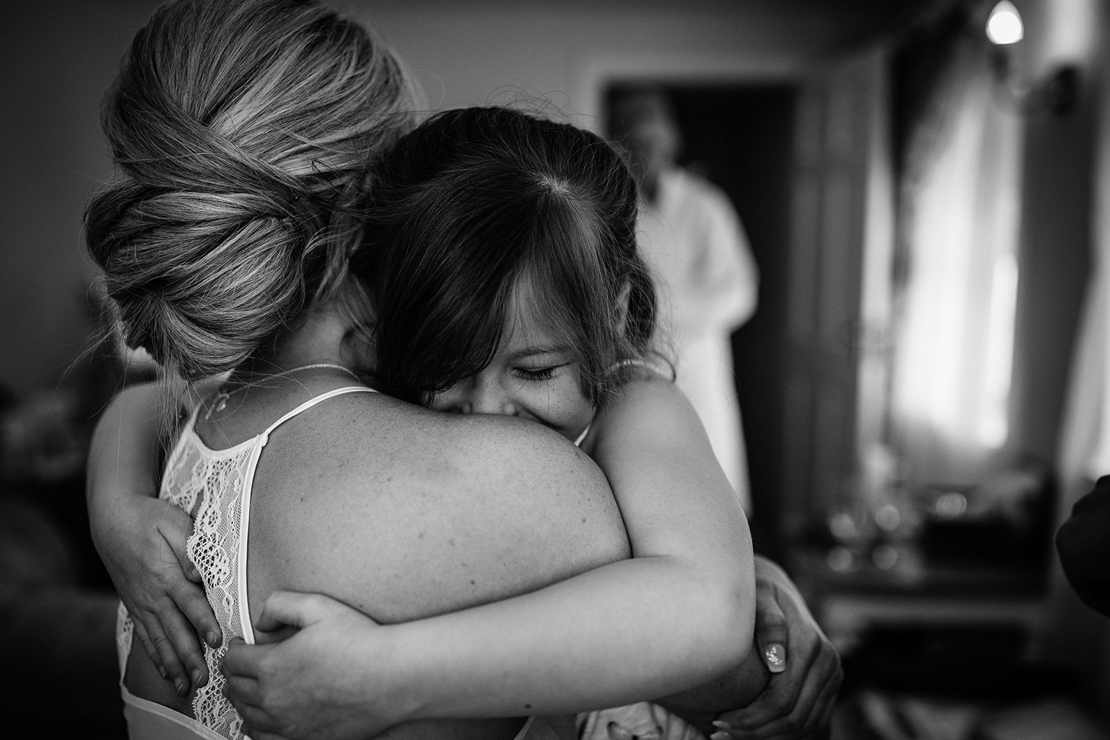 Flower girl hugs at a Sandhole Oak Barn Wedding