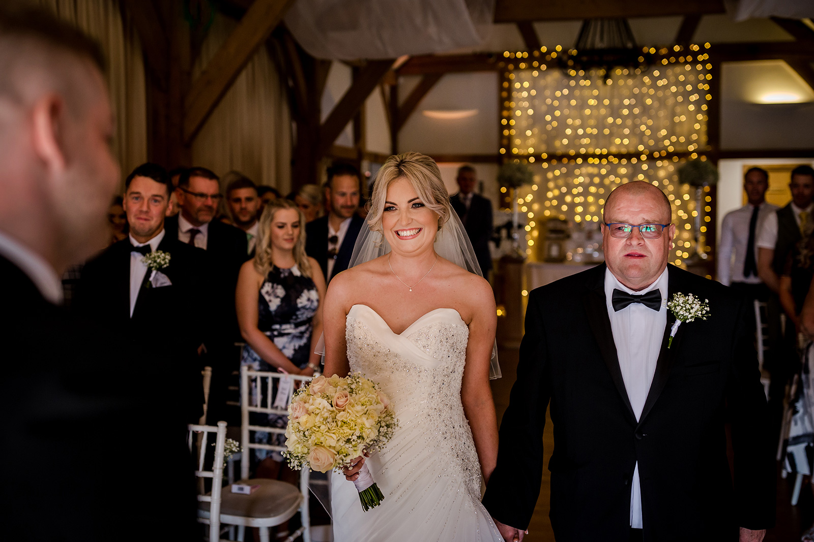 The bride arrives with her dad during a Sandhole Oak Barn Wedding Ceremony