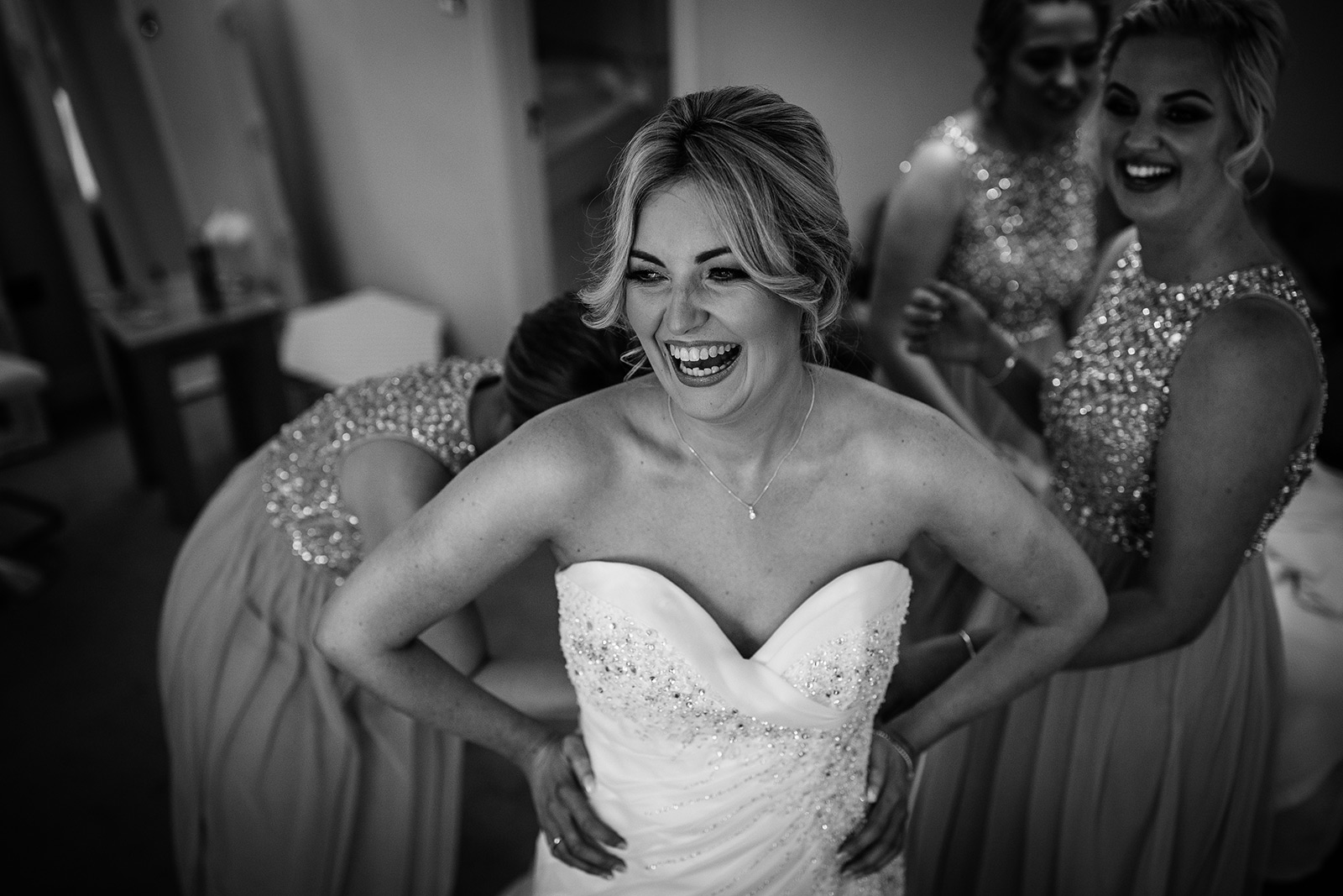 The bride almost ready during her Sandhole Oak Barn Wedding in Cheshire