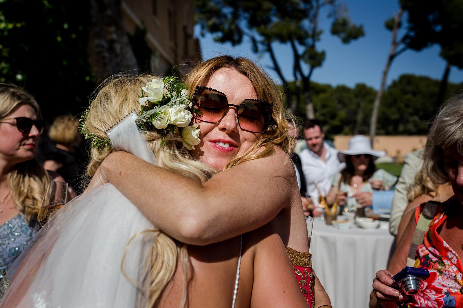 Hugs at a Torre del Veguer Wedding in Sitges