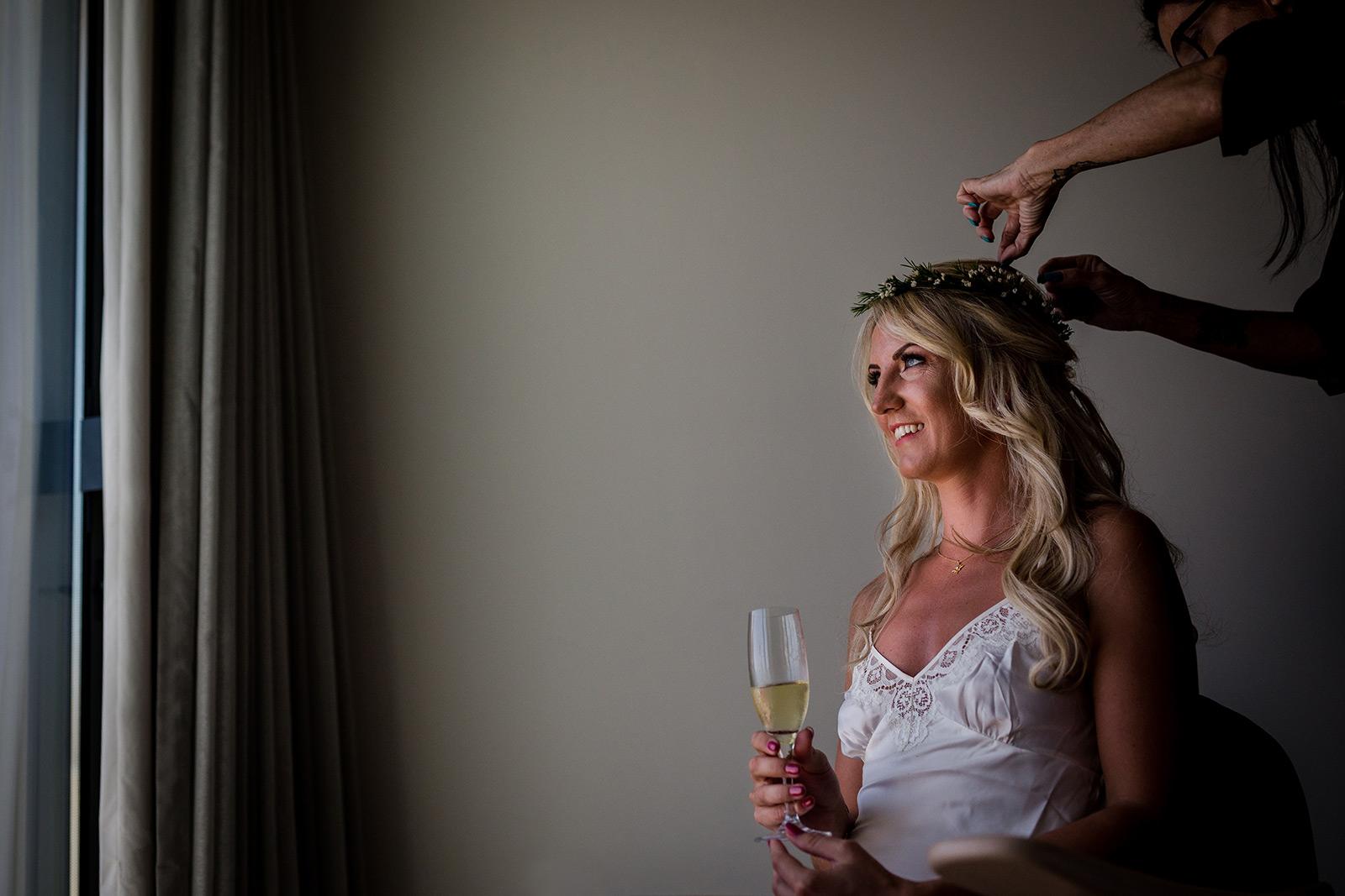 The bride having her make up done at her Torre del Veguer wedding